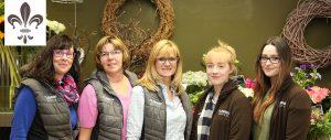 Foto mit allen Mitarbeiterinnen, den Auszubildenden und der Geschäftsinhaberin Lydia Niehüser-Koprivsek